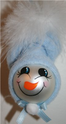Handpainted Baby Boy Snow Baby Ornament with Blue Fleece Hat and White Mirbeau Feathers atop his hat