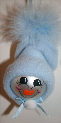 Handpainted Baby Boy Snow Baby Ornament with Blue Fleece Hat and Blue Mirbeau Feathers atop his hat