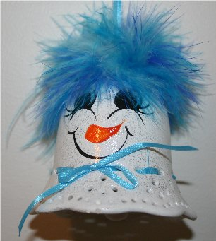 Handpainted Porcelin bells turned into a snowmen - She is wearing blue mirbeau feathers on top of her head and has a cheerful handpainted face, and is accented with a coordinating ribbon around her neck and is ready for hanging on your Christmas Tree