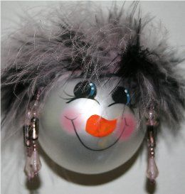 Snowman Ornament with brown and gray mirbeau feather hair with a handpainted face and rosy cheeks