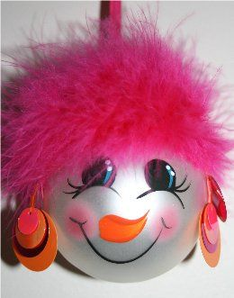 Snowman ornament with hot pink mirbeau feather hair, neon pink and orange earrings, with a handpainted face and rosy cheeks