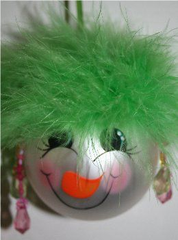 Snowman Ornament with neon green mirbeau feathers, coordinating earrings and a handpainted face with rosy cheeks