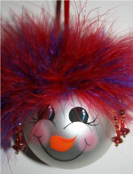Snowman ornament with red and purple mirbeau feather hair with red or purple earrings and a handpainted face with rosy cheeks