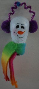 Snowman Ornament Handpainted on an appliance light bulb.  He is wearing a multi-colored fleece scarf, purple pompom ear muffs which are connected with a sparkling purple pipe cleaner
