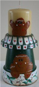 Gingerbreadman candle, handpainted on terra cotta pots.