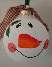 Frosted ornament painted white for a country snowman accented with holly and a berry and finished with a country ribbon drapping over his head