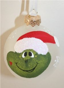 "Mrs. Frog handpainted on a 2 5/"" frosted ornament.  She is wearing a red santa hat and has a heart on hear cheek"