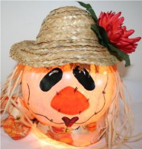 Handpainted Scarecrow Nightlight with coordinating fall ribbon and decorative mum